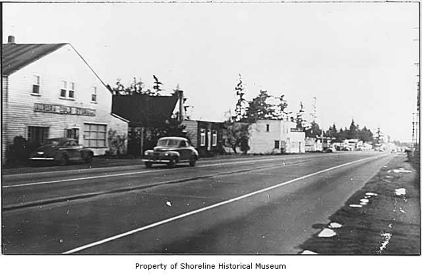 Aurora_Avenue_North_with_a_view_of_Braytons_Cold_Storage_Graneys_Shoe_Repair_Coxs_Garage_Ronald_ca_1948(x568)